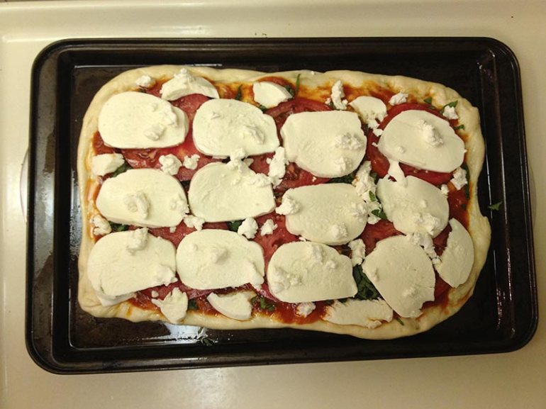 We baked the pizza on a square cookie sheet since I don't have a round pizza size baking sheet.